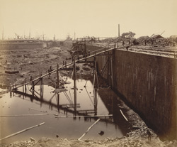 View of East wall from S.E. corner looking N. [Victoria Dock construction, Bombay].